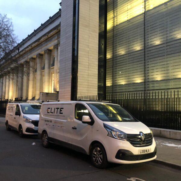 Vans by Office Windows